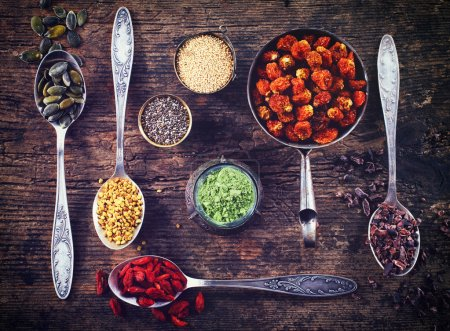 Photo for Various superfoods on wooden  background - Royalty Free Image