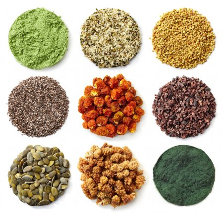 Collection of various circles of superfoods isolat...