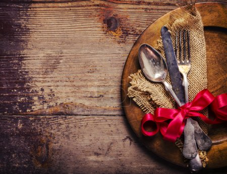 Photo for Vintage silverware decorated with red ribbon - Royalty Free Image