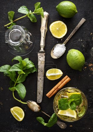 Photo for Mojito ingredients on rustic black background - Royalty Free Image