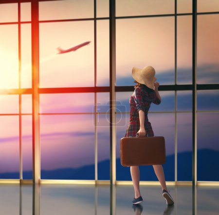 woman looks at a plane