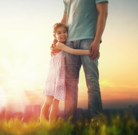 Photo for Happy loving family. Father and his daughter child girl playing and hugging outdoors. Cute little girl hugs daddy. Concept of Father's day. - Royalty Free Image