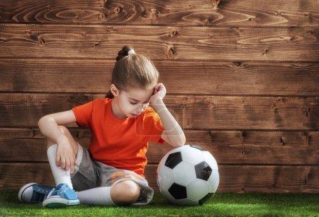 Girl plays football