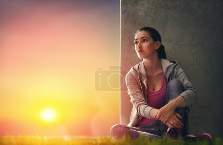 Photo for Athletic young woman running in the nature. Girl resting after an active fitness training. Healthy lifestyle. - Royalty Free Image