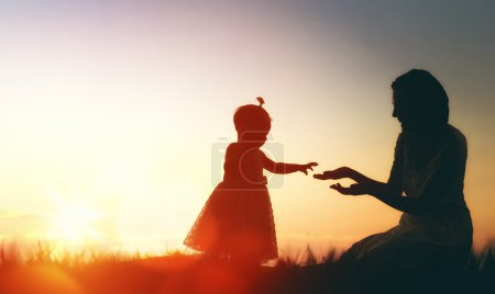 Photo for Happy loving family. Mother and her daughter baby girl playing and laughing in the summer at sunset outdoors. - Royalty Free Image