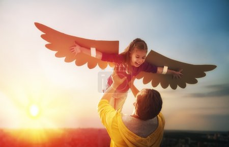 Photo for Father and his daughter child playing together. Little girl plays in the bird. Happy loving family having fun. - Royalty Free Image