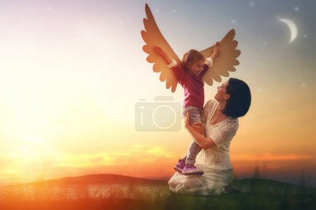Photo for Mother and her daughter child playing together. Little girl plays in the bird. Happy loving family having fun. - Royalty Free Image