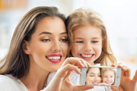 Photo for Mother and daughter making a selfie - Royalty Free Image