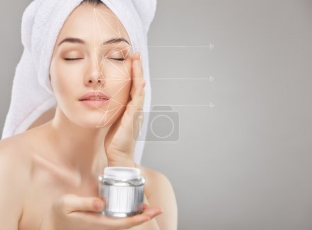 applying cosmetic cream