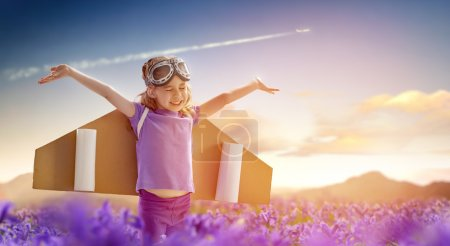 Photo for Child is dressed in an astronaut costume - Royalty Free Image