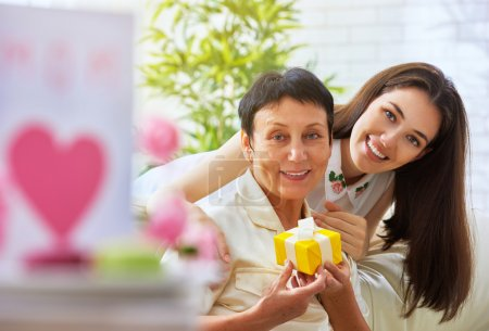 Photo for Mother and daughter with gift - Royalty Free Image