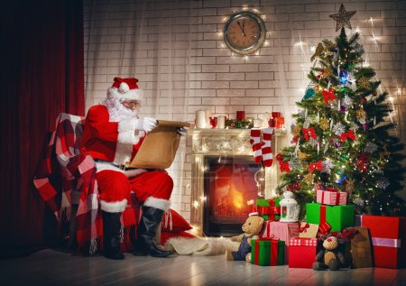 Photo for Portrait of Santa Claus sitting at his room at home near Christmas tree - Royalty Free Image