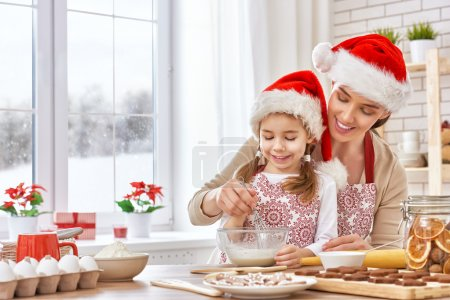 Photo for Mother and daughter cooking Christmas biscuits - Royalty Free Image