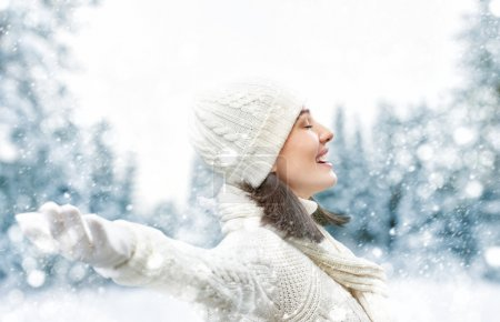 Photo for Happy young woman on a winter walk in nature. - Royalty Free Image