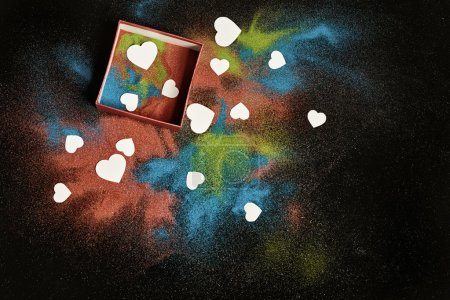 colored sand and white hearts
