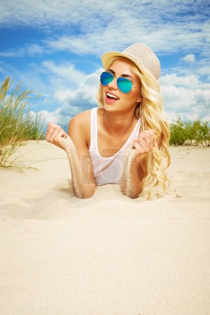 Photo for Long blonde haired girl in bikini on beach - Royalty Free Image