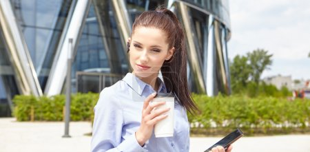 Businesswoman Walking On Street Holding Coffee
