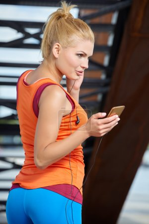 Female athlete with mobile phone