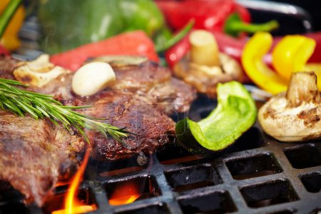 Photo for T-bone steak grilled on a barbecue - Royalty Free Image