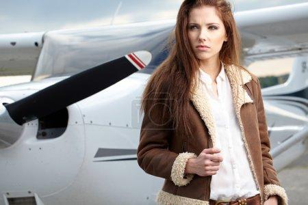 Woman aviator in airport