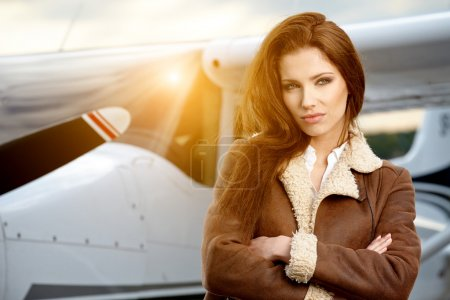 Woman aviator in airport