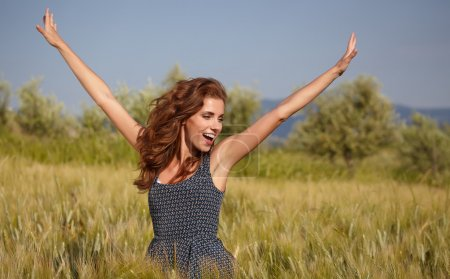 Photo for Young beautiful woman  in the Toscana field - Royalty Free Image