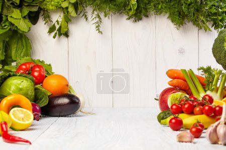 Fruit and vegetable borders on wooden table
