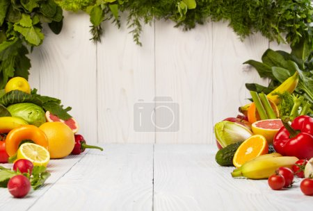 Photo for Fruit and vegetable borders on white wooden old table - Royalty Free Image