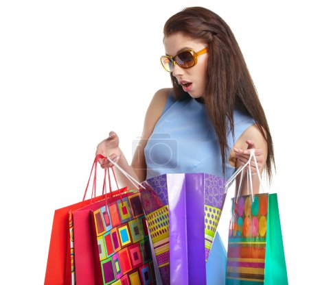 Photo for Lovely woman with shopping bags over white - Royalty Free Image