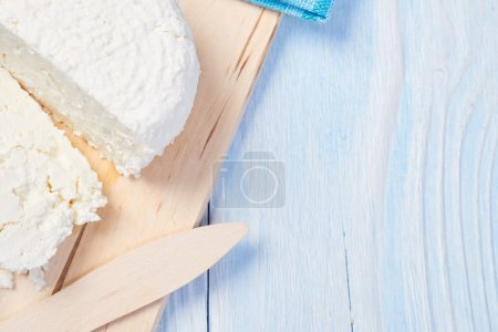 Cottage cheese on wooden board