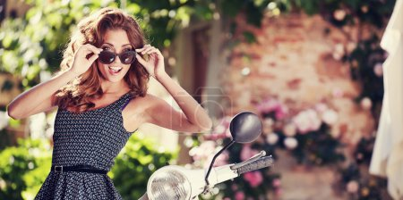 summer girl on scooter