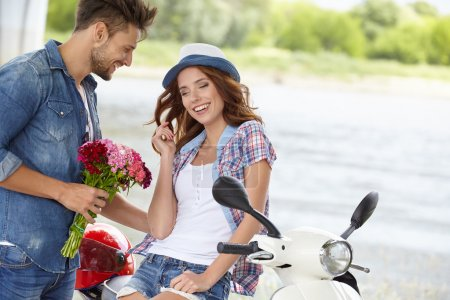 man gives flowers beautiful woman
