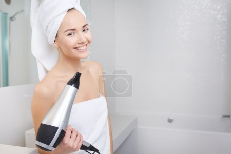 woman wrapped in white towel
