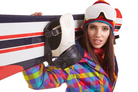 woman standing with snowboard
