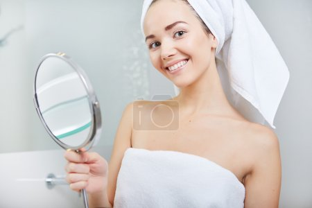 beautiful healthy woman and reflection in the mirror