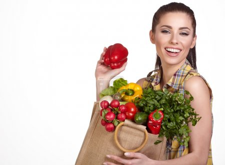 Photo for Woman holding shopping bag with fresh food, Isolated studio shoot - Royalty Free Image