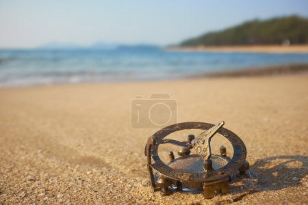beach with vintage sundial