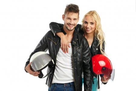 Photo for Motorcyclists couple with helmets in hands, isolated on white background - Royalty Free Image