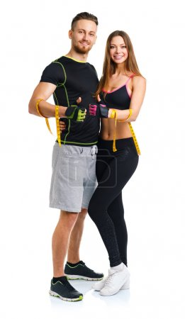 Happy sport couple - man and woman with measuring tape on the wh