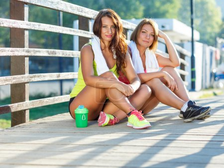 Two girls have a rest after exercising