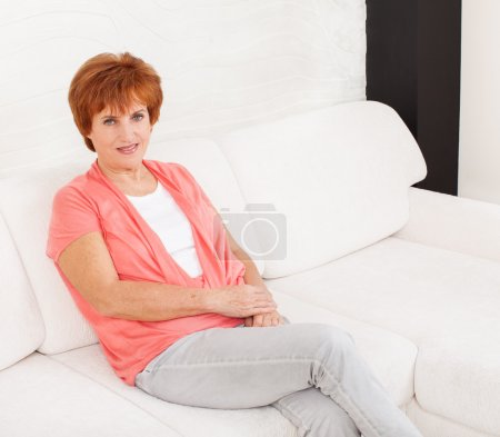 Photo for Woman on sofa at home. Adult female - Royalty Free Image