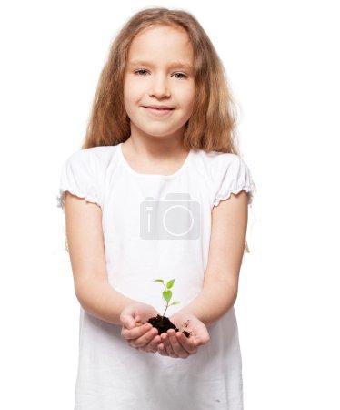 Photo pour Un enfant tenant une luge. Fille avec germe - image libre de droit