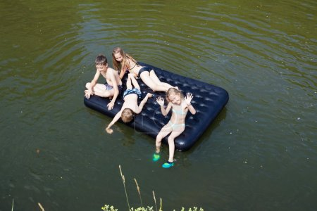Children floating on the river