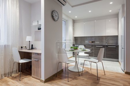 Photo for Interior of a new modern apartment in scandinavian style with kitchen and workplace - Royalty Free Image