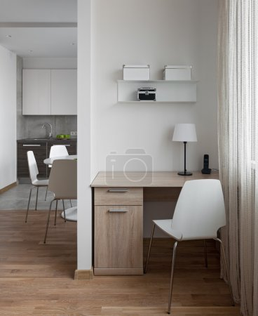 Interior of modern apartment in scandinavian style with workplac