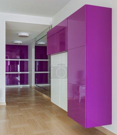 Interior of empty wardrobe room in pink colors