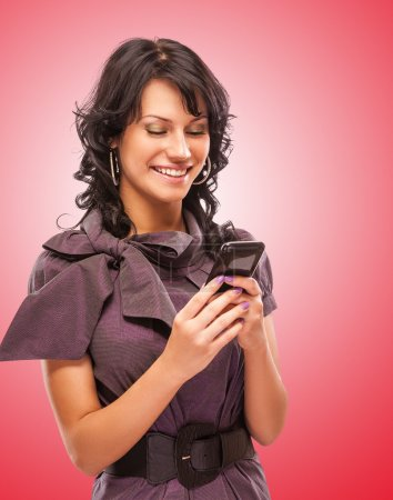 Charming girl reads sms on phone