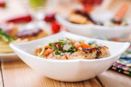 bowl of salad (radishes, tomatoes, parsley, eggs), meat katlety
