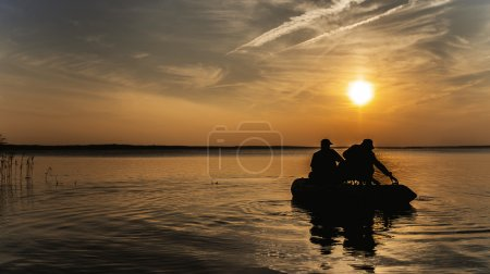 Fishermen in rubber boat