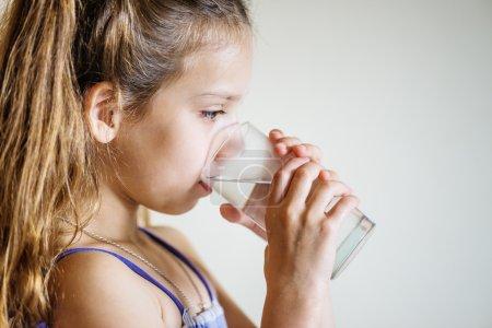 Little girl drinks water